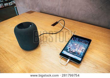 Paris, France - Dec 16, 2018: Apple Computers Ipad Tablet Next To New Apple Homepod Wireless Speaker