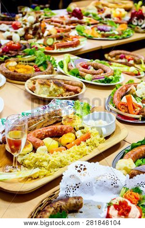Decorated sausages with fresh vegetables are exposed on traditional sausage tournament. poster