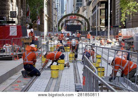 Sydney, Nsw, Australia-november 24, 2018: Laying Tiles On The Light Rail (tram) Construction Site In