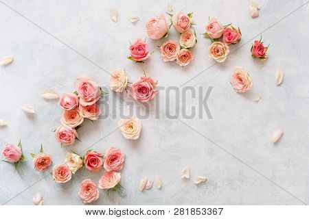 Roses On Textured Background. Various Pink Roses Buds And Petals  Scattered On Rustic Background, Ov