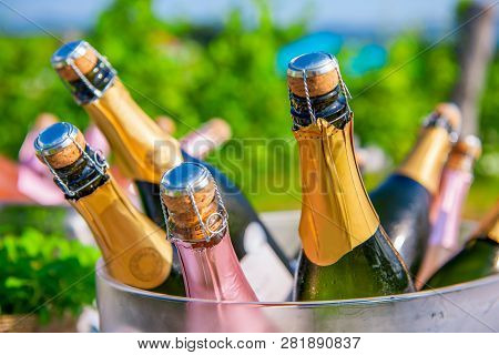 Bottles Of Champagne, Sparkling Wine In Cooler At Wedding Reception Outdoors, Wedding And Summer Par