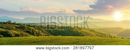 Panorama Of Romania Countryside At Sunset In Evening Light. Wonderful Springtime Landscape In Mounta