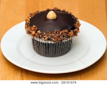 Chocolate Cupcake With Crushed Walnuts And Macadamia Nut