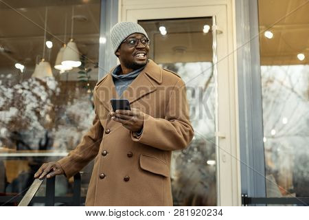Beaming Father Waiting For His Family Near Their Favorite Restaurant