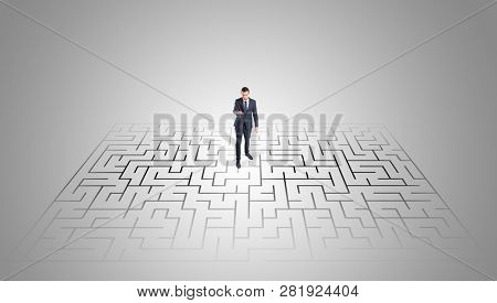 Elegant businessman looking for a solution in a middle of a maze