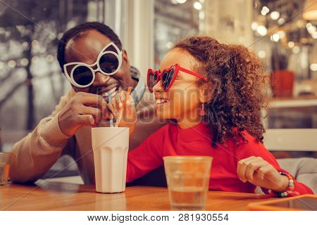 Little Cute Curly Girl Celebrating Fathers Day With Her Supportive Father