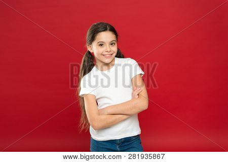 Enjoy Every Moment. Young And Free. Happy Child Girl With Long Hair On Red Background. Happiness And
