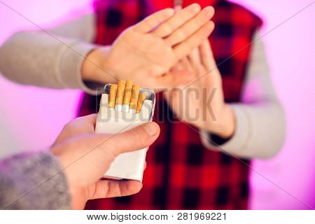 Quitting Smoking Concept. Hand Is Refusing Cigarette Offer. Stop Smoking And Healtcare Concept
