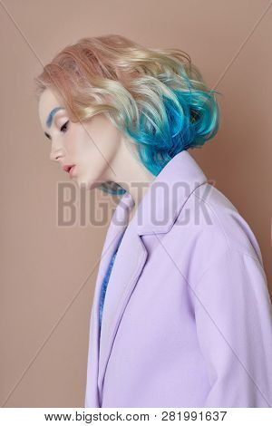 Portrait Woman Spring Bright Colored Flying Hair, All Shades Purple Blue. Hair Coloring, Beautiful L