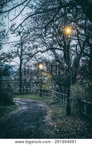 Evening Street Scene, Nitra, Slovak Republic. Lantern, Railing And Trees. Analog Photo Filter With S