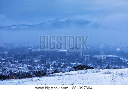 Snowy Landscape With Nitra City And Zobor Hill, Slovak Republic. Evening Time. Beautiful Seasonal Sc