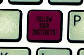 Writing note showing Follow Your Instincts. Business photo showcasing listen to your intuition and listen to your heart Keyboard key Intention to create computer message pressing keypad idea. poster