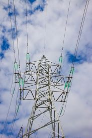 High voltage electricity feeder on the blue sky bacground
