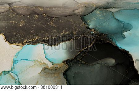 Abstract black, blue and gold glitter color background. Marble texture. Alcohol ink colors.