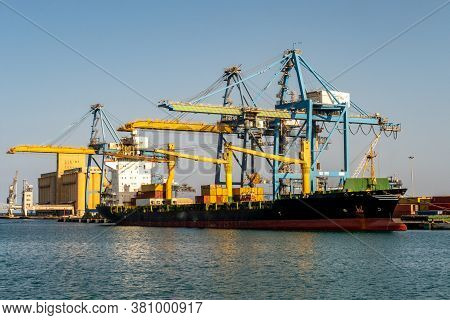 Port Sudan, Sudan, 07/04/19. Container Ship Msc Alice Under Flag Of Liberia Being Loaded With Contai
