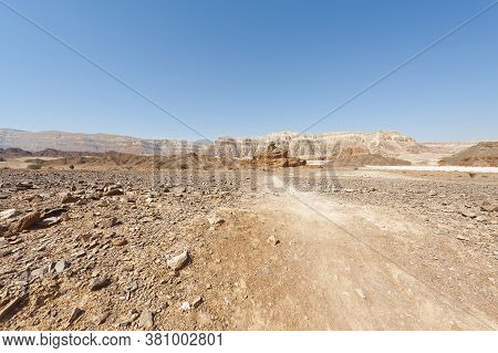 Melancholy And Emptiness Of The Rocky Hills Of The Negev Desert In Israel. Breathtaking Landscape An