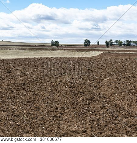 Plowed Sloping Hills Prepared For Planting Crops In Spain In The Autumn. Rural Landscape With Field