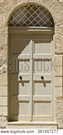 Building With Traditional Maltese Door In Historical Part Of Mdina. The City Was Founded As Maleth I