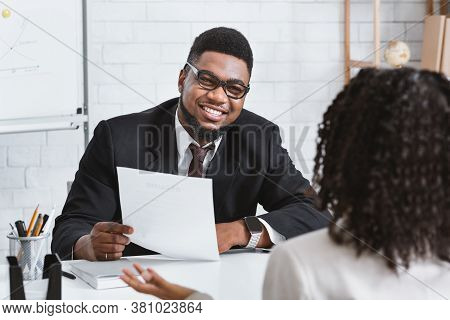 Happy Personnel Manager And Young Job Applicant On Work Interview At Modern Company Office