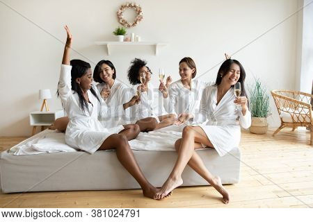 Women In Bathrobes After Spa Drinking Champagne Celebrating Bridal Shower