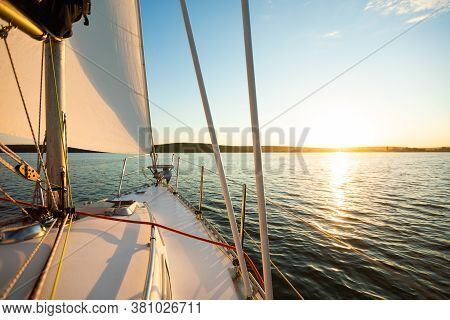 White Yacht Or Catamaran Sailboat Sailing In The Sea On Summer Day. Yachting On Vacation. Empty Spac