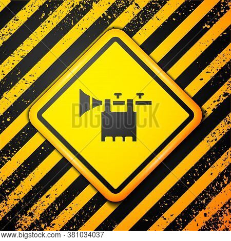 Black Trumpet With Flag Icon Isolated On Yellow Background. Musical Instrument Trumpet. Warning Sign