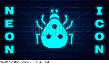 Glowing Neon Ladybug Icon Isolated On Brick Wall Background. Vector