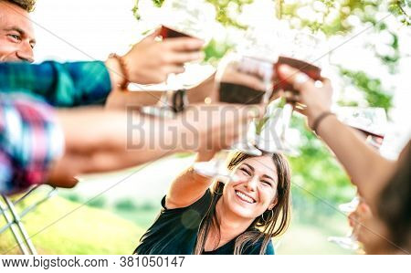 Hands Toast With Red Wine - People Having Fun Cheering At Pic Nic Winetasting - Young Friends Enjoyi