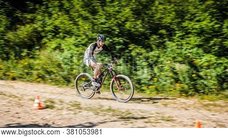 Krasnogorsk, Russia - August 16, 2020: Rider In Action At Freestyle Mountain Bike Downhill Style. Bi