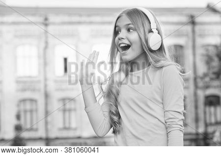 Give Five. Happy Kid Open Hand In Greeting Outdoors. Little Child Listen To Music. Stereo Sound Tech
