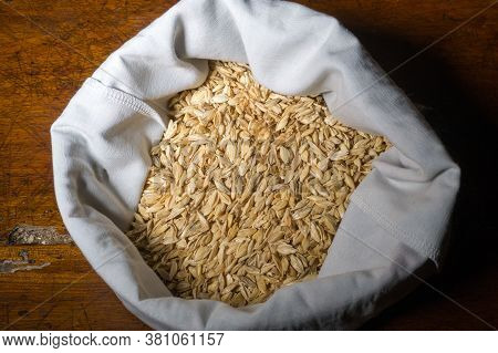 Cotton Bag And Rice Husk. The Husks Are The First Skin Of The Rice Grain, The Protection Of The Grai