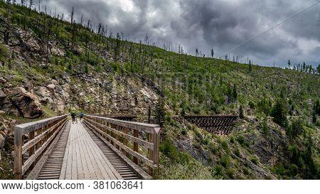 Biking Over The Wooden Trestle Bridges Of The Abandoned Kettle Valley Railway In Myra Canyon Near Ke