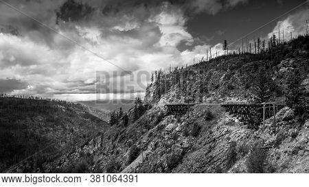 Black And White Photo Of A Series Of Wooden Trestle Bridges Of The Abandoned Kettle Valley Railway I
