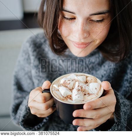 Christmas, Cold Winter Day. Warming Mood. Woman Drinking Warm Cocoa With Marshmallows. Holiday Weeke