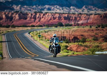 Motorbike On The Road Riding. Empty Road On A Motorcycle Tour Journey. Travel American Concept