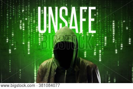 Faceless hacker with UNSAFE inscription, hacking concept