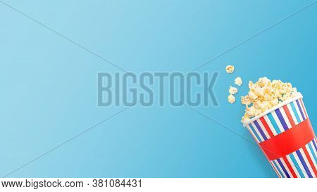 Paper Cups That Are Overturned With Delicious Popcorn On A Light Blue Background With Space For Text