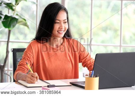 Work From Home,  Asian Women Working Online With Laptop Computer At Home Office, Asia Female Making