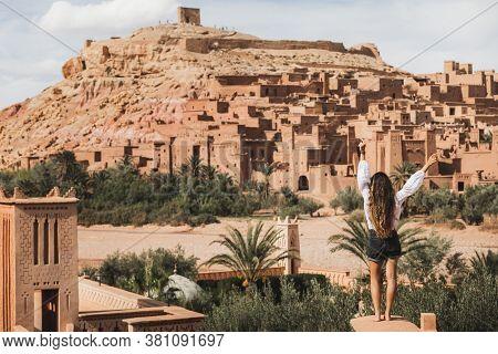 Woman Enjoying Popular Landmark Ksar Ait-ben-haddou. View From Behind. Travel In Morocco, Ouarzazate