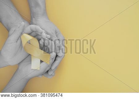 Adult And Child Hands Holding Yellow Gold Ribbon, Sarcoma Awareness, Bone Cancer, Childhood Cancer A