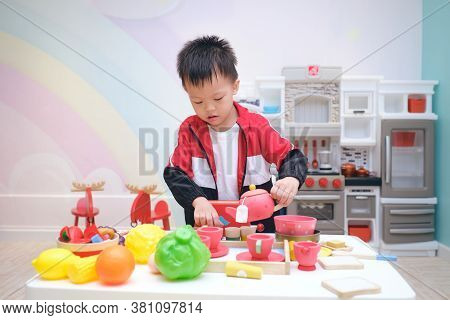 Cute Little Asian 3 -4 Years Old Toddler Boy Child Having Fun Playing Alone With Cooking Toys, Kitch