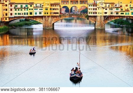 ARNO RIVER, FLORENCE, ITALY, 10 AUGUST 2020: Touristic boat on Arno River in Florence, Tuscany, Europe
