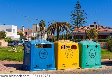 Ciutadella, Menorca - October 15, 2019: A Row Of Colorful Dustbins For Waste Segregation.
