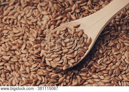 Flax Seeds Linseed On Wooden Spoon. Healthy Food For Preventing Heart Diseases And Overweight