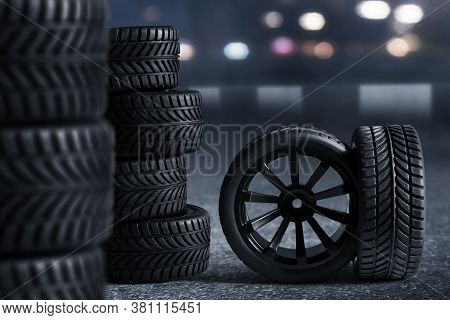 Car Tires On The Street At Night