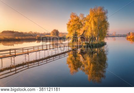 Old Fisherman House And Wooden Pier At Sunrise In Autumn. Aerial View. Beautiful Landscape With Hous