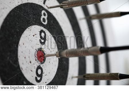 Dart Shot To Bull Eye Of Dartboard Among Others Close-up