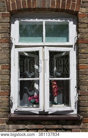 Old Tenement House Window. Urban Landscape Background. Brown And Red Brick Wall And Wooden Window Fr