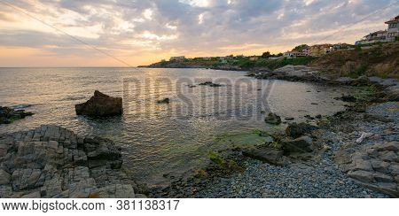 Sunset At The Coast Of Black Sea. Wonderful Dramatic Landscape With Rocks On The Pebble Beach Beneat