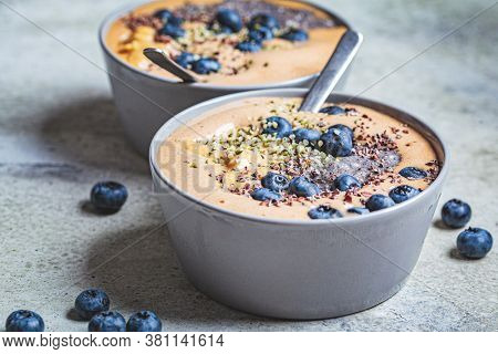 Vegan Breakfast - Chocolate Smoothie Bowl With Chia Pudding, Peanut Butter And Berries In A Gray Bow